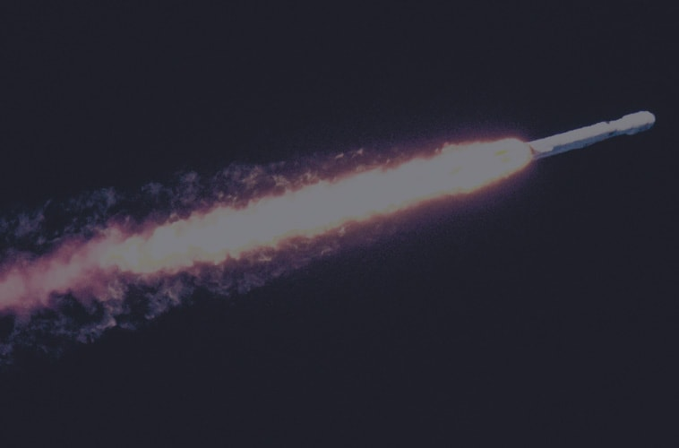 rocket with long fire and exhaust trail